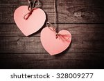 Pink heart made of paper on...