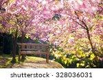 garden bench under the pink... | Shutterstock . vector #328036031