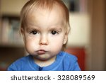 cute blond baby boy with puffed ... | Shutterstock . vector #328089569
