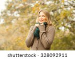smiling woman holding her scarf ... | Shutterstock . vector #328092911