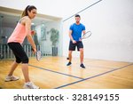 couple play some squash... | Shutterstock . vector #328149155