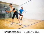 couple play some squash... | Shutterstock . vector #328149161