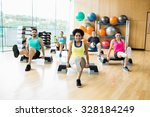 fitness class exercising in the