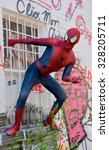 Постер, плакат: Man dress as Spiderman