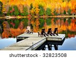 Wooden Dock With Chairs On Cal...