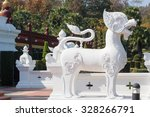 white lion sculpture in front...