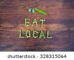 "sign ""eat local"" made of green... 
