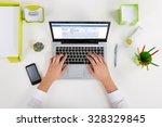 Small photo of High Angle View Of Businessperson Banking Online On Laptop At Desk