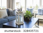 Small photo of Beautiful Blue Accented Living Area with Coffee Table, Couch and Chairs of Home.