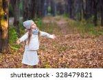adorable little girl outdoors... | Shutterstock . vector #328479821