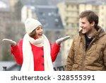 Happy Couple Enjoying Snow In ...