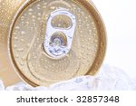Close Up of a Golden Soda Can with Pull Tab and Condensation white background - stock photo