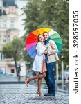 Couple With An Umbrella On The...