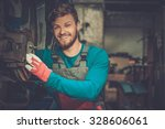 mechanic checking car brake... | Shutterstock . vector #328606061