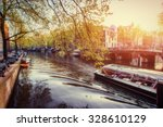 Stock photo amsterdam canal at sunset amsterdam is the capital and most populous city in netherlands 328610129