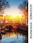 Stock photo amsterdam canal at sunset amsterdam is the capital and most populous city in netherlands 328610135