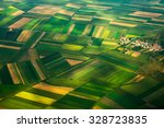 Small photo of aerial photo from a plane, top view, field roads and city
