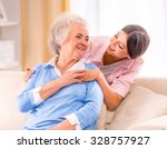 Stock photo care of senior woman at home sitting on the couch 328757927
