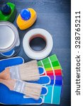 Small photo of Paint containers color sampler protective gloves paintbrushes duct tape.