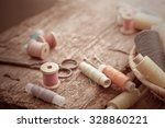 scissors  bobbins with thread... | Shutterstock . vector #328860221