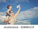 father and son playing in the... | Shutterstock . vector #328884119
