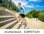 Young Man Jogging At Stairs...