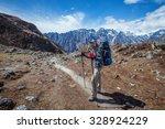 hiker on the trek in himalayas  ... | Shutterstock . vector #328924229