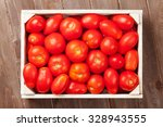 Red Tomatoes Box On Wooden...