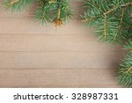spruce branches on wooden... | Shutterstock . vector #328987331