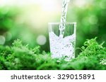 the glass of cool fresh water...   Shutterstock . vector #329015891