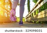 fitness girl running in a field ... | Shutterstock . vector #329098031