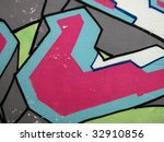 Segment of colorful urban graffiti background on a wall of a building - stock photo
