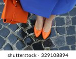 women's legs in orange shoes.... | Shutterstock . vector #329108894