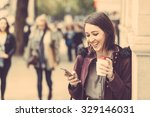 young woman in london standing... | Shutterstock . vector #329146031