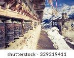 prayer wheels in high himalaya... | Shutterstock . vector #329219411