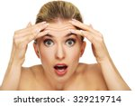 a young woman checking wrinkles ... | Shutterstock . vector #329219714