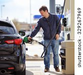 man filling gasoline fuel in... | Shutterstock . vector #329267969
