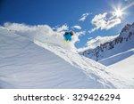 skier skiing downhill in high... | Shutterstock . vector #329426294