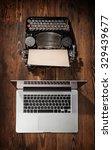 Old Typewriter With Laptop...