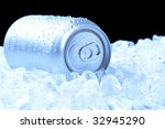 Aluminum Drink Can with water droplets laying in a bed of ice - black background and cool tones - stock photo