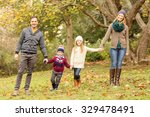 smiling young family posing... | Shutterstock . vector #329478491