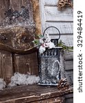 Small photo of winter lamp for candle outdoor on threshold