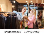 happy young girls in  shopping... | Shutterstock . vector #329493959