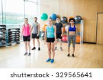 fitness class in the studio at... | Shutterstock . vector #329565641