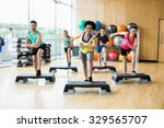 fitness class exercising in the ... | Shutterstock . vector #329565707