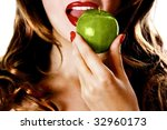 Pretty woman eating a green apple - stock photo