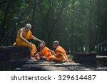 old monk teaching a little... | Shutterstock . vector #329614487