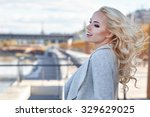 woman in autumn city | Shutterstock . vector #329629025