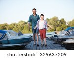 man and boy fishing on the lake ...   Shutterstock . vector #329637209