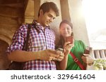 Couple Reading An Sms On A...